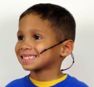 child wearing the headclip with lavaliere mic
